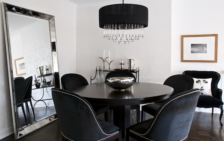 dining table and black velvet dining chairs with silver nailhead trim