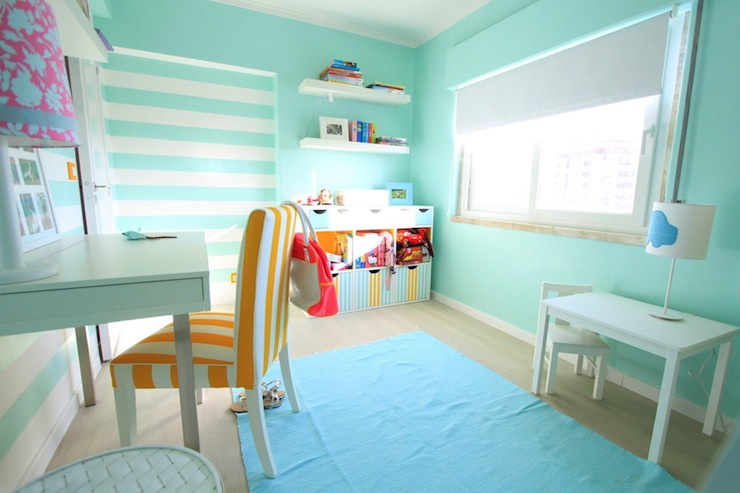 Fun teen girl s bedroom with turquoise blue walls paint color  chunky white  floating shelves  ocean blue rug  white desk and white   yellow striped  chair. Turquoise Girls Room Design Ideas