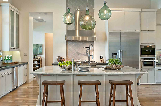 Beautiful Kitchen With Green Glass Pendants, White Kitchen Cabinets With  Black Granite Countertops, White X Kitchen Island With Light Granite  Countertops, ...