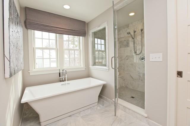 Monochromatic master bathroom with lilac gray walls paint color  purple ish  gray linen roman shade  freestanding modern tub  marble tiles floor and  seamless. Bathroom With Roman Shade Design Ideas