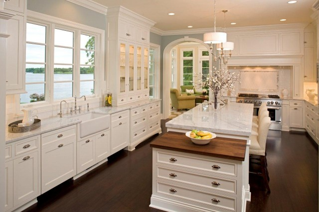 Beautiful Kitchen With Creamy White Kitchen Cabinets With Marble Countertops Farmhouse Sink Slate Blue Walls Paint Color And White Kitchen Island With