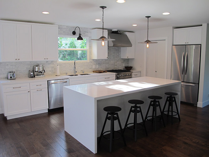 with creamy white kitchen cabinets with white quartz countertops