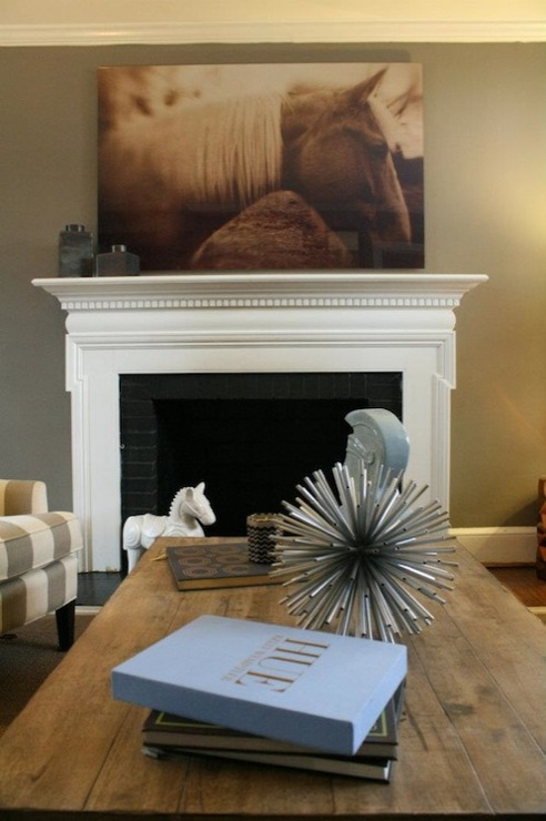 Sweet Living Room With Warm Gray Walls Paint Color Horse Photography Art White Fireplace Mantle Black Brick Tiles Salvaged Wood Cocktail Table And