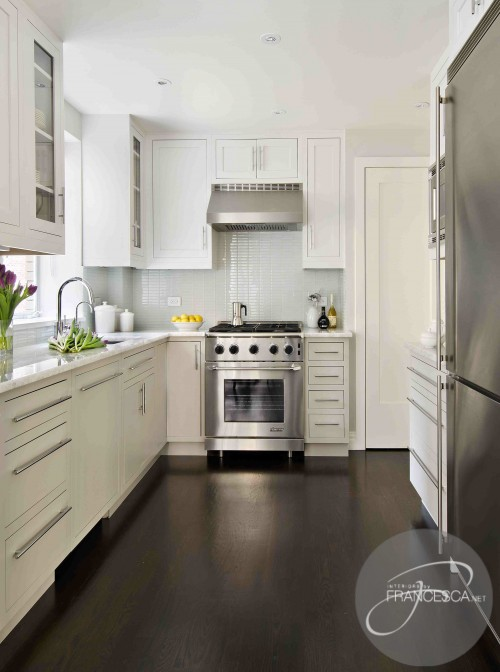 white kitchen cabinets with dark wood floors- cottage - kitchen