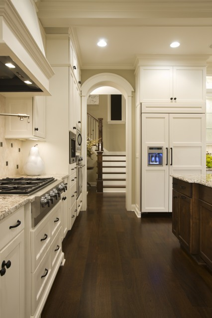 Amazing Two Tone Kitchen Design With Creamy White Kitchen Cabinets Painted Benjamin Moore White Dove Granite Countertops Wood Panel Refrigerator