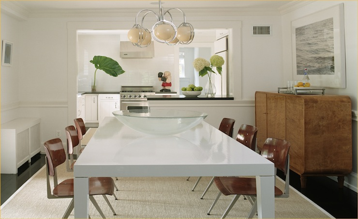 Modern Dining Room With Chair Rail Glossy White Parsons Table Industrial Wood Chairs Jute Rug And Mid Century Buffet