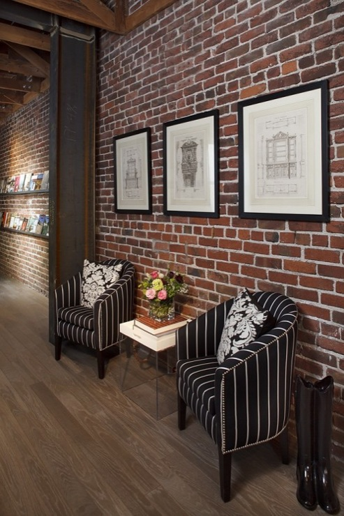 chic foyer with exposed brick walls white black striped chairs with. Black Bedroom Furniture Sets. Home Design Ideas