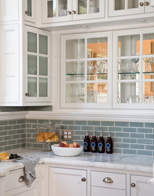 Love Blue Glass Tiles   White Glass Front Kitchen Cabinets With Marble  Countertops And Blue Glass Tiles Backsplash.