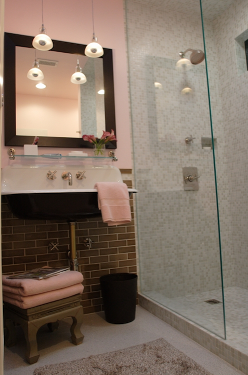 Leslie Sachs - Pink & gray bathroom with pink walls paint color, gray glass  subway tiles backsplash, Kohler Sink, taupe Asian Stool, pink towels and ...