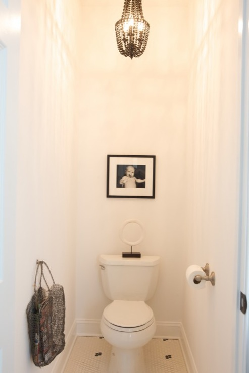 small powder room with vintage penny tiles floor black white photo