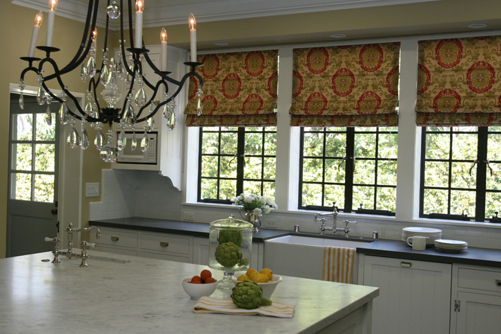 Traditional kitchen with white beadboard cabinets with for Roman shades for kitchen windows
