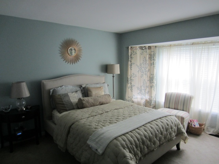Light Blue Bedroom With Sunburst Mirror