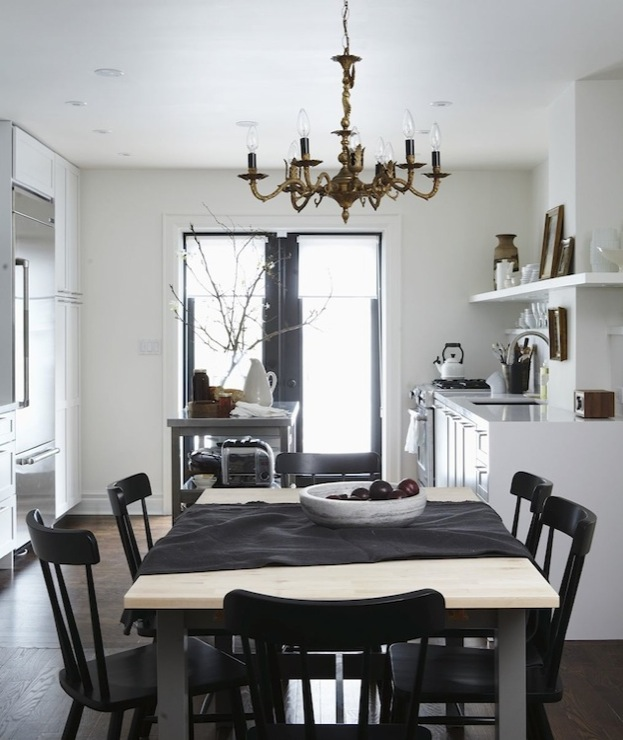 gorgeous eclectic dining room with metal dining table with oak top