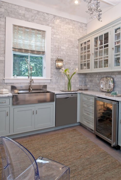 ... Kitchen Cabinets With Marble Countertops, Stainless Steel Apron Sink,  Marble Subway Tiles Backsplash, Wine Fridge, Jute Rug And Kartell Ghost  Chair.