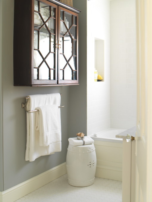 Beautiful Bathroom With Gray Walls Paint Color, Glass Front Lattice Wall  Bathroom Cabinet And White Garden Stool.
