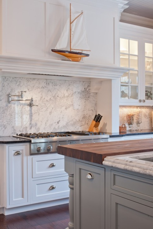 Lovely Two Tone Kitchen Design With Creamy White Shaker Kitchen Cabinets,  Polished Black Granite Countertops, Gray Kitchen Island With Marble U0026  Butcher ...