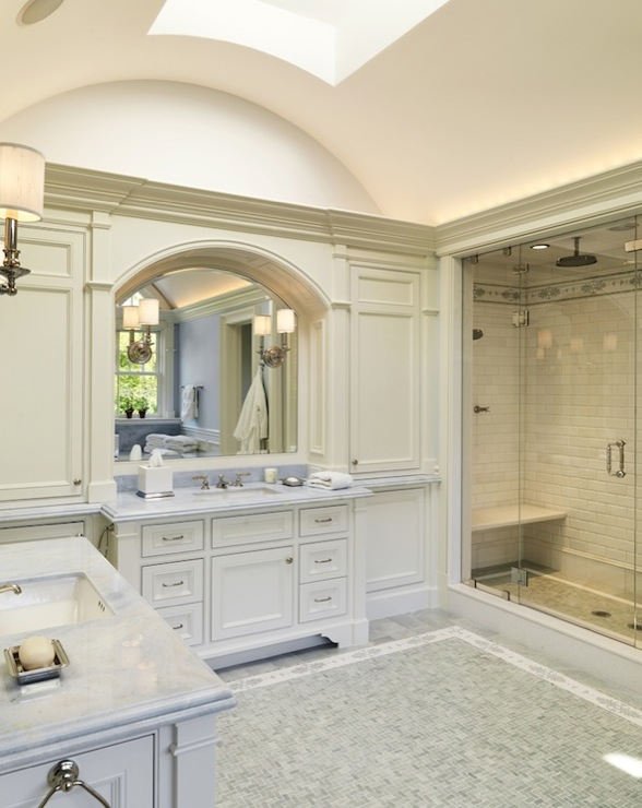 Ensuite With Skylight In Curved Ceiling Ivory Built In Bathroom Cabinets Twin Single Ivory Bathroom Cabinets With Marble Countertops Arched Mirrors