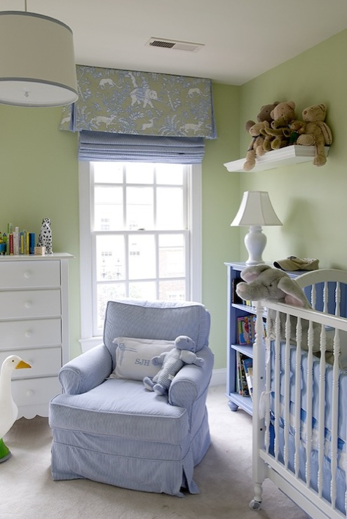 Adorable blue & green nursery design with green walls paint color, white  crib, blue bookshelf, blue glider, drum pendant with blue ribbon trim, ...