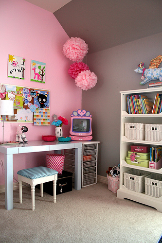 sweet girls room with gray pink walls paint color west elm parsons desk in glossy white pink pom poms pink tv and white bookshelf