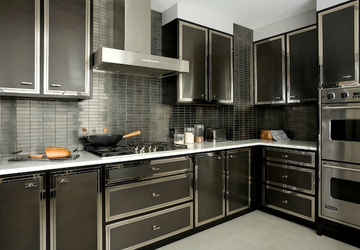bold black modern kitchen with glossy black kitchen cabinets marble countertops black stacked tiles backsplash and double ovens