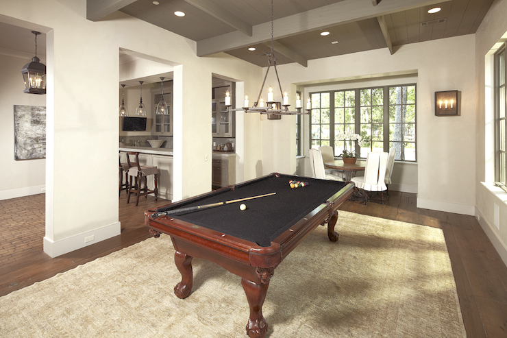 dining room used as game room with oriental rug pool table gray ceiling breakfast nook round wood table and skirted slipcover dining chairs