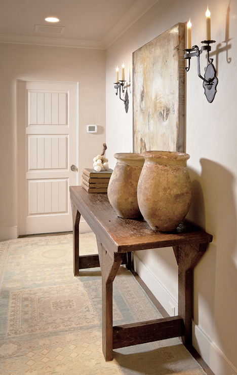 Elegant Foyer With Wood Console Table, Rustic Jugs, Books, Art And Oriental  Rug.