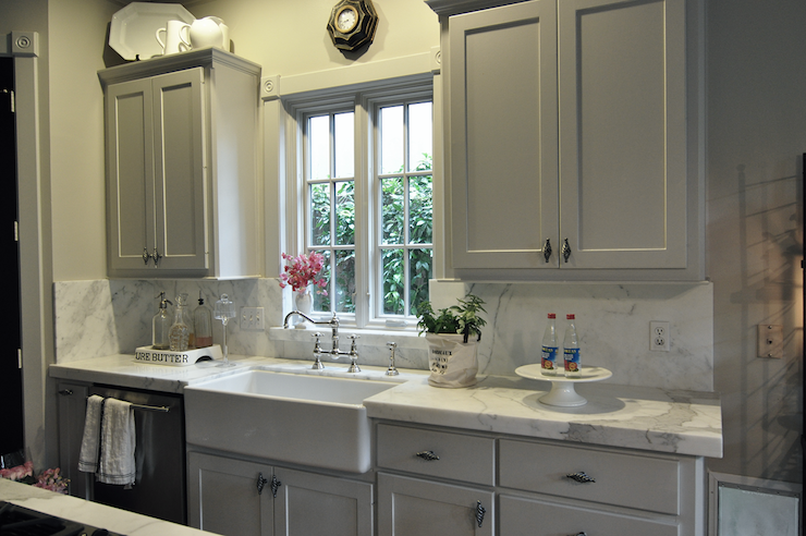 Chic Kitchen With Custom Mixed Gray Paint Kitchen Cabinets Calcutta Ora Marble Slab Countertops Backsplash Farmhouse Sink Polished Nickel Bridge Faucet