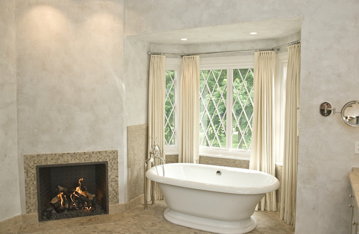 Huge master bathroom with venetian plaster walls  fireplace with Napolina  Limestone mosaic miniature tiles  Kohler vintage freestanding tub and ivory. Venetian Plaster Bathroom Design Ideas