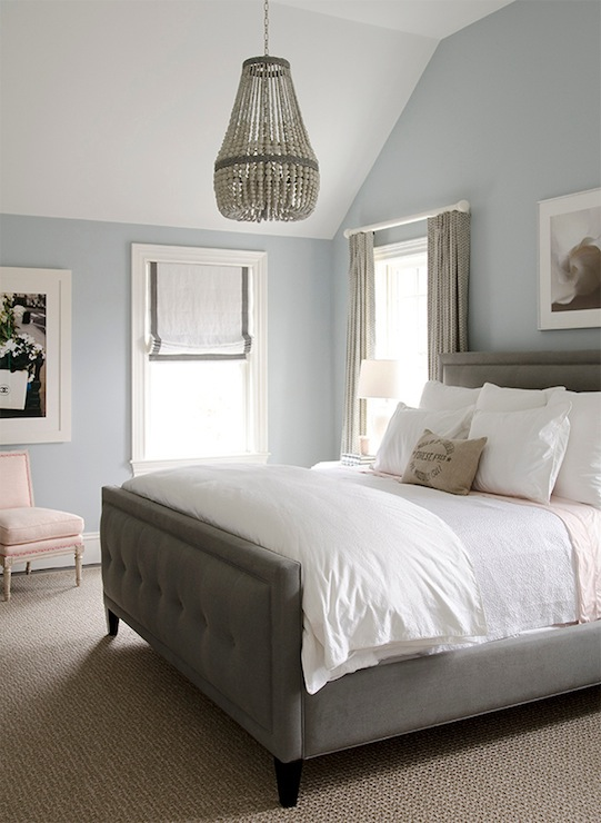 Gorgeous bedroom with blue walls paint color, gray linen tufted bed ...