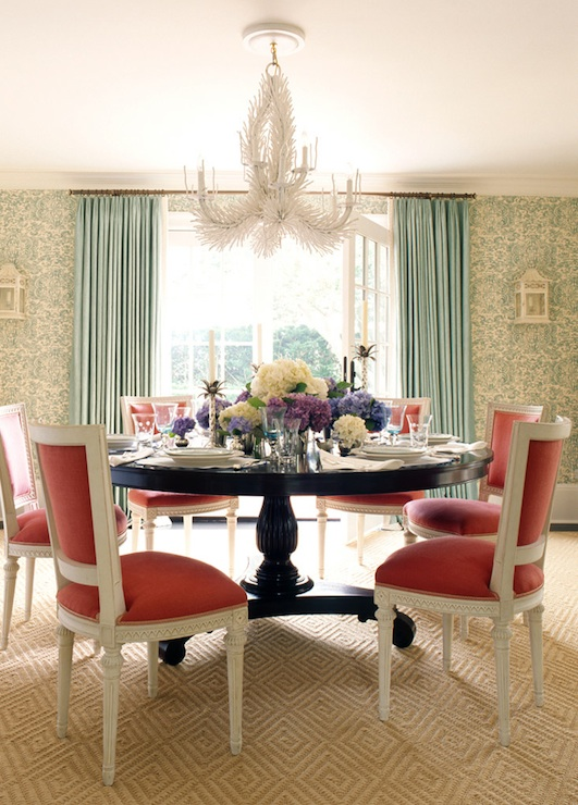 Elegant Dining Room With White Coral Chandelier Glossy Wood Pedestal Table Red French Back Chairs Diamond Pattern Wool Rug Teal Blue