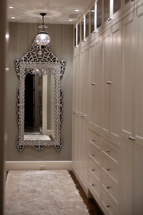 walk in closet with venetian floor mirror gray walls paint color