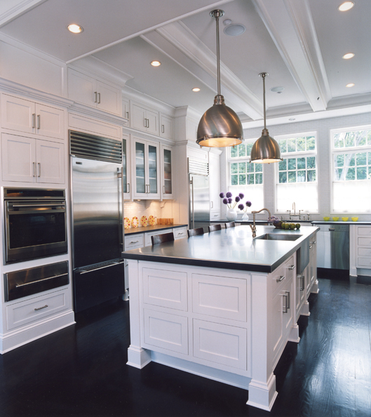 kitchen cabinets & kitchen island with black quartz countertops and