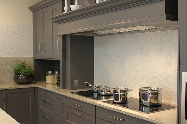 Gray kitchen with gray kitchen cabinets, granite countertops and