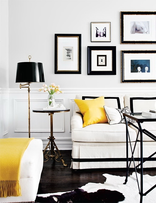 Irene Langlois - Black & yellow living room with chair rail & wainscoting,  art gallery, white skirted William Birch Sofa with black ribbon trim, ...