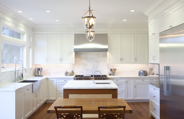 Gorgeous Kitchen With Creamy White Shaker Kitchen Cabinets White Marble Countertops And Backsplash Glass Lanterns Over Kitchen Island With Sink