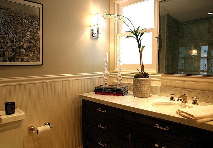 guest bathroom with gray walls paired with pencil rail and beadboard