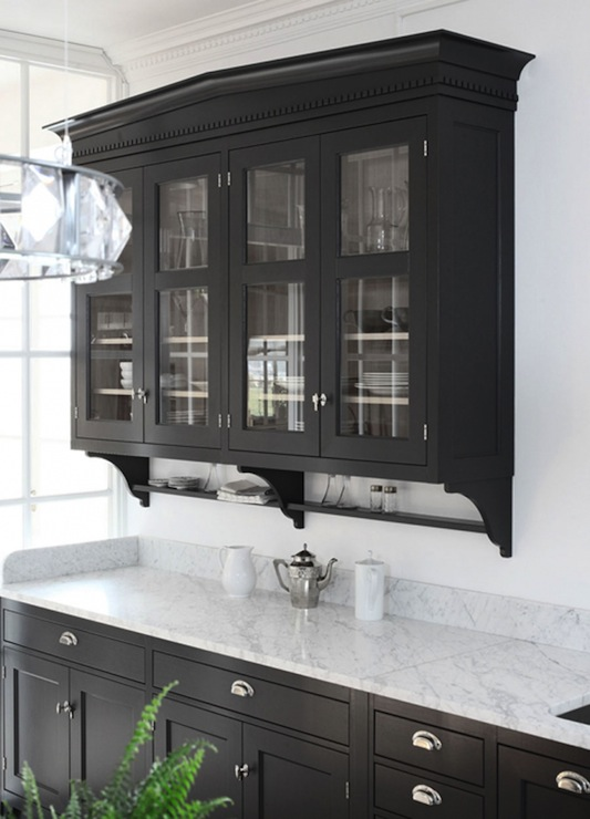 Kitchen With Glass Front Upper Cabinets And Black Lower Cabinets