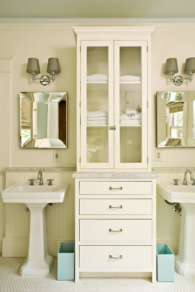 Elegant Chic, Elegant Bathroom For Two With Ivory Walls, His And Her Pedestal Sinks  Flanking Glass Front Linen Cabinet, Beveled Mirrors, Beadboard Backsplash,  ...