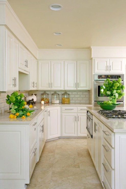 white kitchen cabinets travertine floor white quartz countertops transitional kitchen tobi 28954