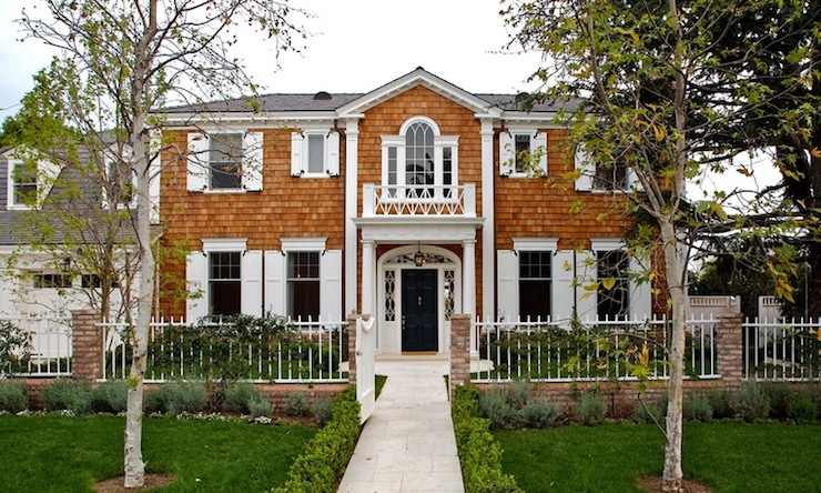 Colonial Home Style With Attached Two Car Garage And White Picket Fence