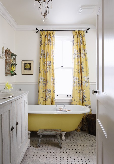 Sarah Richardson   Gray And Yellow Bathroom With Gray Walls, Gray Claw Foot  Tub Placed In Front Of Window Covered In Yellow Curtains And Vintage Gray  Stool ...