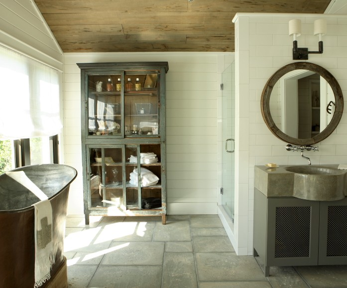 Chic Rustic Bathroom With Gray Vintage Glass Front Cabinet Storing All  Bathroom Supplies, Seamless Glass Shower, Cast Iron Freestanding Tub In  Front Of ...