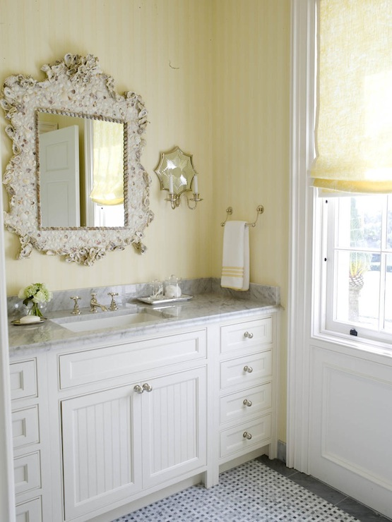 Superieur Beachy Bathroom With Sunny Yellow Tone On Tone Striped Wallpaper, Ornate  Seashell Encrusted Mirror, White Single Vanity With Beadboard Doors And  White ...