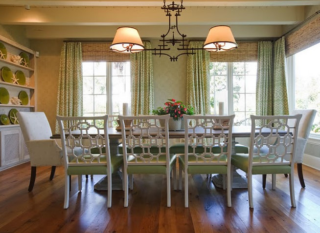 Lovely Tan And Green Dining Room With White Box Beams Floor To Ceiling Geometric Curtains Layered Over Bamboo Roman Shades Faux Chandelier
