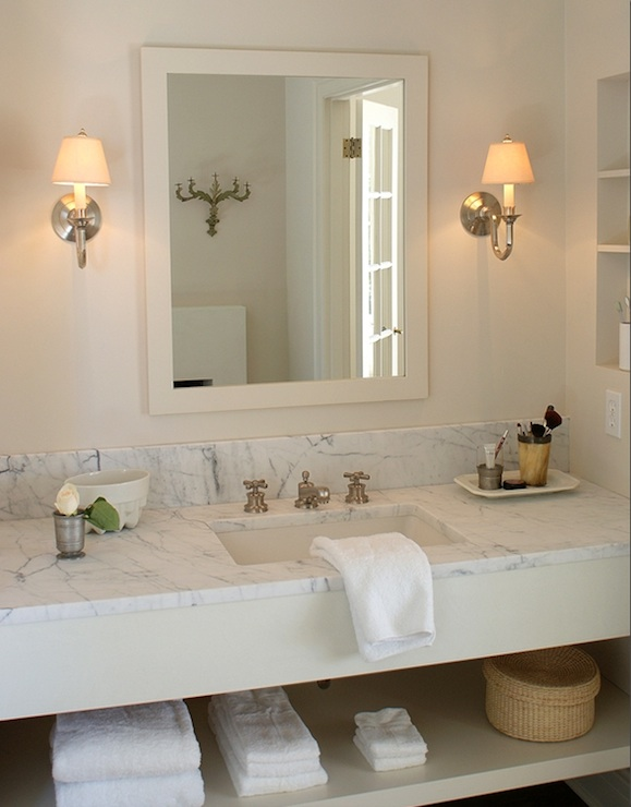 Chic Master Bathroom With Cream Vanity With White Marble Countertop With  Shelving Holding Towels, Brushed Nickel Single Sconces Flanking Cream  Lacquer ...