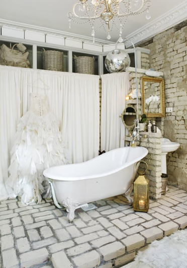 Swedish Bathroom Design With Exposed Brick Walls Vintage Claw Foot Tub Over Paved Floor Gold Lantern Wall Of Built In Cabinets Covered In Off White