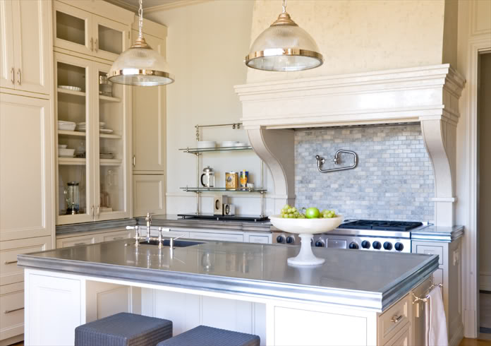 Lovely Ivory Kitchen With Ivory Cabinets Paired With Zinc Countertops And Marble Mini Brick Tile Backsplash Cream Kitchen Hood With Corbels With Pot Filler