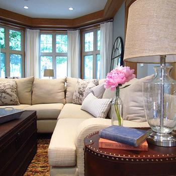 Sectional below windows design ideas for Ivory couch living room ideas