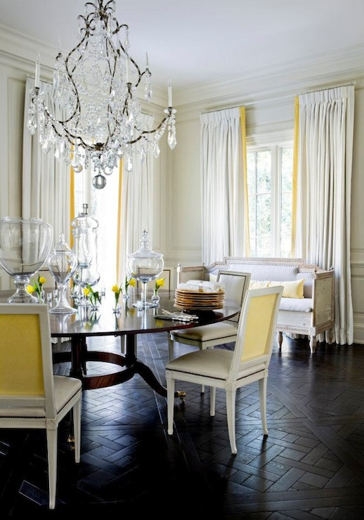 Yellow And Gray Dining Room With Soft Paneled Walls White Curtains Canary Ribbon Trim Dark Wood Herringbone Floors Crystal Chandelier