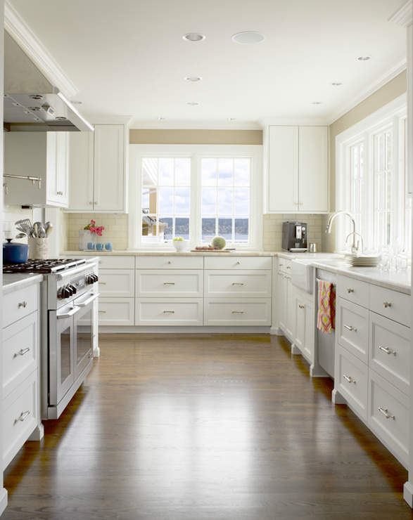 Clean Crisp Kitchen With Cafe Au Lait Walls Crisp White Cabinets With White Marble Countertops And Farmhouse Sink
